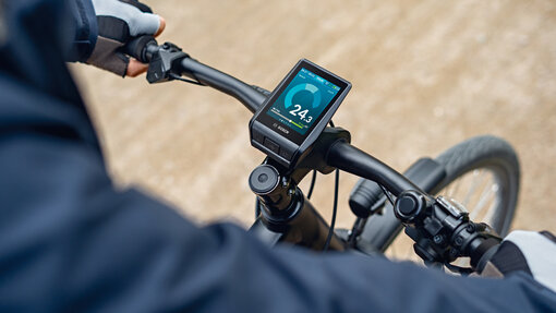 Close-up view of Nyon display showing speed output on black Trekking eBike.