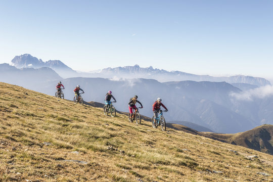A group of women ride Class-1 electric mountain bikes in the Bavarian Alps of Germany.
