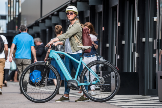 Woman uses a Bosch powered electric bike for commuting to work.